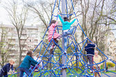 Children climb on the jungle gym at the park — Stock Photo