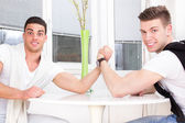 Two surprised men arm wrestling — Stock Photo