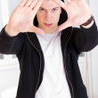 Urban trendy guy wearing hood framing his face with hands — Stock Photo #44000299