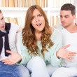 Beautiful woman hasitates between two young men — Stock Photo #44036983