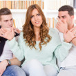 Doubtful beautiful woman hasitates between two young guys — Stock Photo #44037293