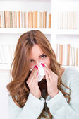 Beautiful girl feeling ill caught cold sniffles blowing her nose — Stock Photo