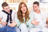 Beautiful woman hasitates between two young men — Stock Photo