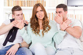 Doubtful beautiful woman hasitates between two young guys — Foto Stock