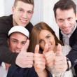 Casual group of successful people make the ok thumbs up sign — Stock Photo #44314737