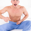 Handsome half naked man having problems with genitals and potenc — Stock Photo #44315325