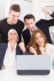 Happy excited business people winning online looking at laptop c — Stock Photo