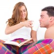 Couple resting in bed having coffee in the morning — Stock Photo #45348443