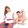 Young couple in love relaxing in bed — Stock Photo #45348647