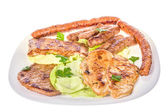 Barbecue of various grilled meat on white plate closeup — Stock Photo