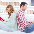 Couple at home reading book — Stock Photo #46140073