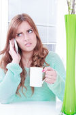 Worried woman receiving bad news over phone — Stock Photo