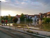 Flooded city with view of road and observers on side — Stock Photo