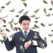 Businessman with clock on his palm concept surrounded by money — Stock Photo #47697219