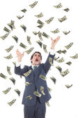 Business man catching falling dollars banknotes and screaming — Stock Photo
