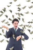 Businessman with money realising he is running out of time — Stock Photo