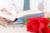 Composition with book, glasses and red rose — Foto Stock