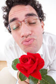 Romantic man with rose giving a kiss — Stock Photo