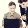 Boss and secretary working together on laptop — Stock Photo