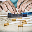Hands of man making cigarettes — Foto Stock