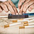 Male hands making cigars with tobacco — Stock Photo #49848223