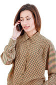 Portrait of young businesswoman talking on mobile phone wearing  — Stock Photo
