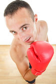 Man with boxing gloves looking at the camera if is anyone there  — Stock Photo