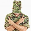 Soldier standing with sign of peace with cross arms — Stock Photo #51392011