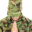 War soldier praying in military camouflage uniform with head bow — Stock Photo #51392209