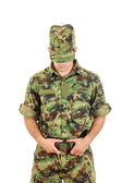Military soldier in camouflage uniform and hat fastened belt — Stock Photo