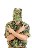 No name soldier standing with sign of peace with cross arms — Stock Photo