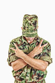Soldier standing with sign of peace with cross arms — Stock Photo
