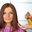 Hair salon. Womens haircut. Use of cosmetic oil. — Stock Photo #33129731