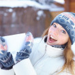 Young beautiful woman with blank banner. Winter. — Stock Photo #33132045