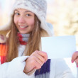 Young beautiful woman with blank banner. Winter. — Stock Photo #33132853