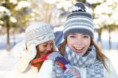 Winter. Young women outdoors. — Stock Photo