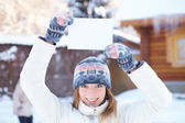 Young beautiful woman with blank banner. Winter. — Stock Photo