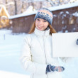 Young beautiful girl with blank banner. Winter. — Stock Photo #33749293