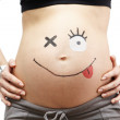 Stock Photo: Pregnancy. Tummy with stuffing.