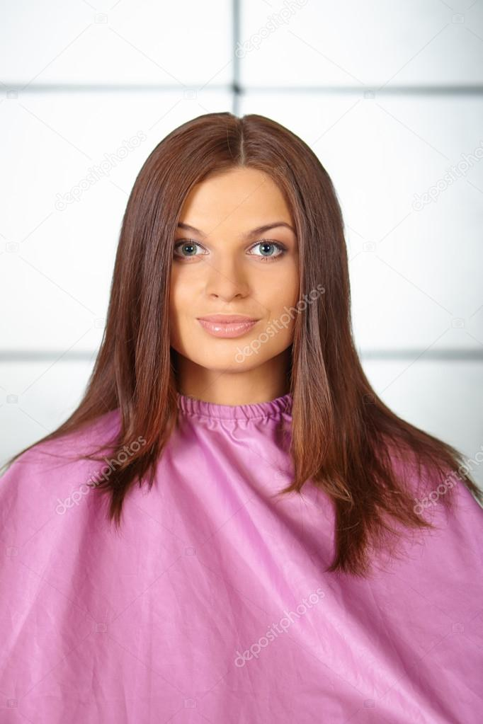 Hair salon young woman in hair cutting gown stock for Salon younga