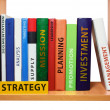 Bookshelf with strategy knowledge and skills. — Stock Photo