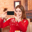 Girl in cafe. Shooting on smartphone. — Stock Photo