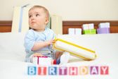 Portrait of baby boy on bed. Birthday concept. — Stock Photo