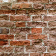 Old red brick wall with damaged bricks. — Stock Photo