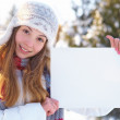 Young beautiful girl with blank banner. Winter. — Stock Photo #34789801