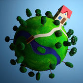 Little green planet with toy house. — Stock Photo