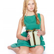 Beautiful blonde young woman with gift box. — Foto de Stock