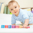 Portrait of baby boy on bed — Stock Photo