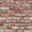 Seamlessly tiling old red brick wall. — Stock Photo