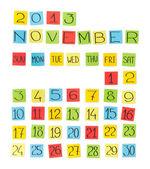Vícebarevná kalendář: listopad 2013. kousky barevného papíru. — Stock fotografie